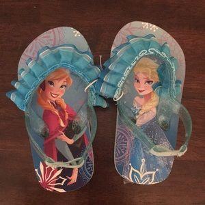 Never worn frozen toddler flip flops size 7/8